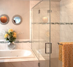 sculpted shower with frameless shower doors